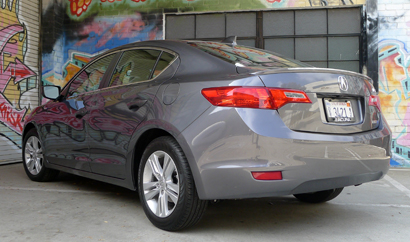 A three-quarter rear view of a 2013 Acura ILX Hybrid