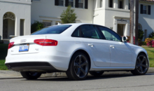 A three-quarter rear view of the 2014 Audi A4 2.0T quattro manual