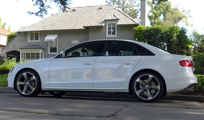 A side view of the 2014 Audi A4 2.0T quattro manual