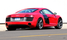 A three quarter rear view of the exotic Audi R8 V10 Coupe