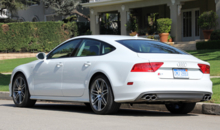 A three-quarter rear view of the 2014 Audi S7 quattro S tronic fastback