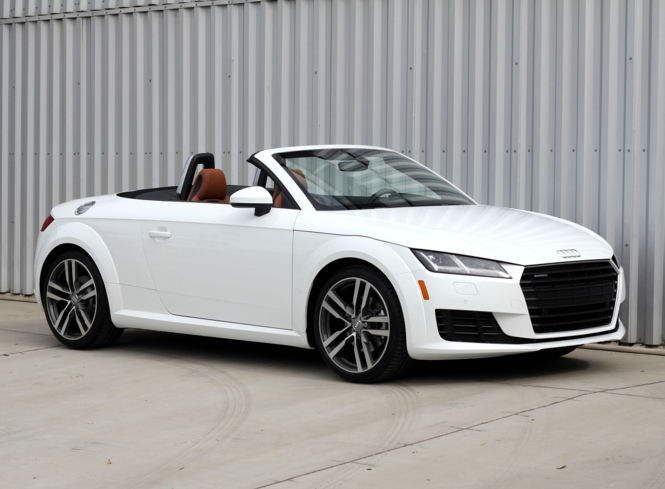 A three-quarter front view of a 2016 Audi TT Roadster 2.0T quattro S tronic shown in Ibis White
