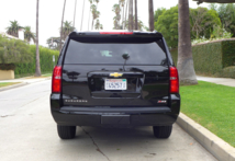 A back view of the 2015 Chevrolet Suburban 4WD 1/2 Ton LT