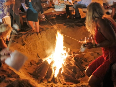 Roasting marshmallows over the bonfire at An Evening On The Beach