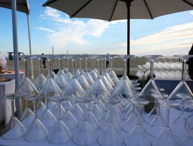 Glasses awaiting specialty cocktails at 2015's An Evening On The Beach