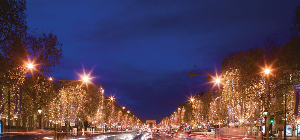 Champs-Élysées in Paris, France attracts crowds on New Year's Eve