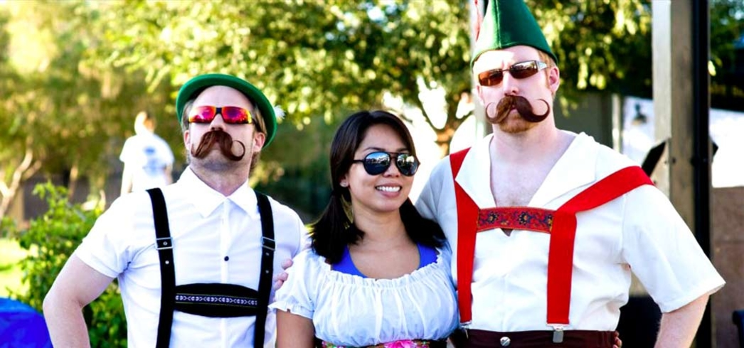 Guests decked in colorful lederhosens during the Tempe Oktoberfest