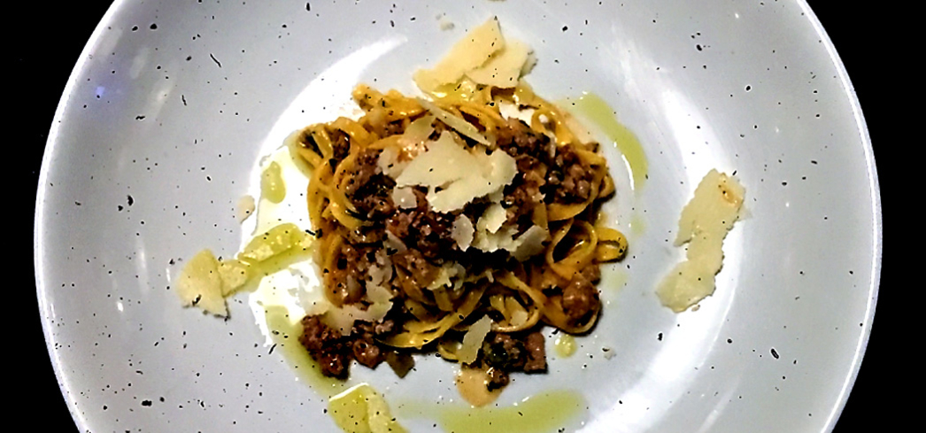 Tagliolini with a pulled rabbit white wine reduction
