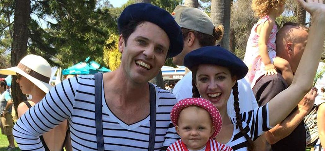 Guests show up in French-themed costumes for the French Festival