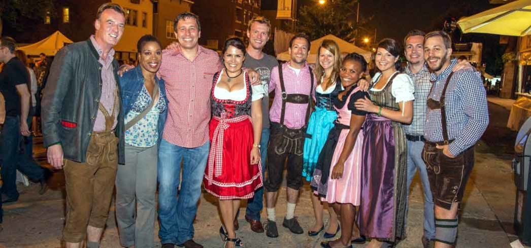 Guests clad in lederhosens gather outside St. Alphonsus for Oktoberfest