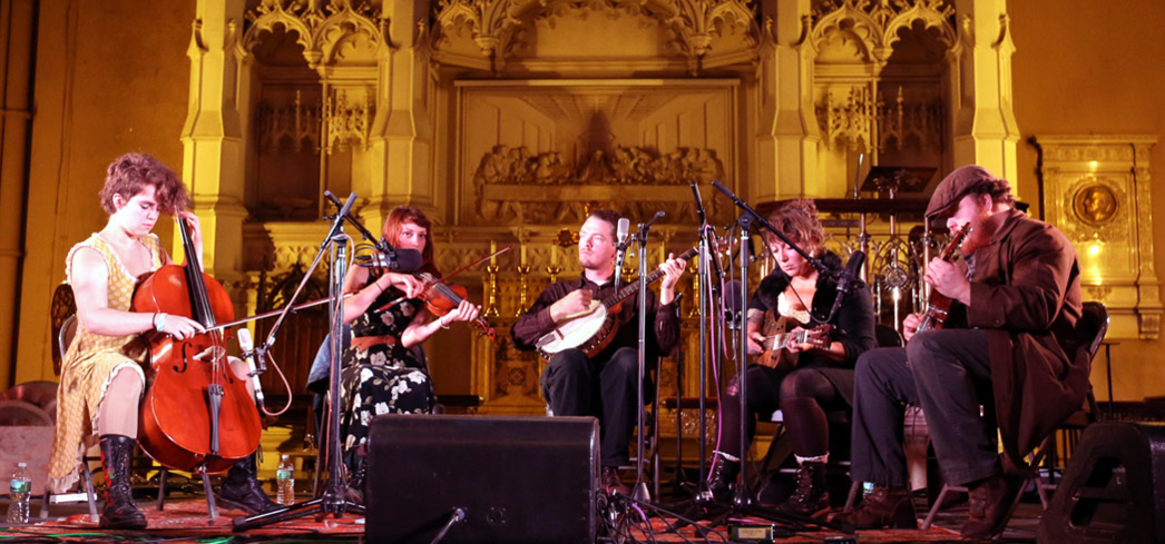 Performers take the stage at St. Ann's Church for the Brooklyn Folk Fest