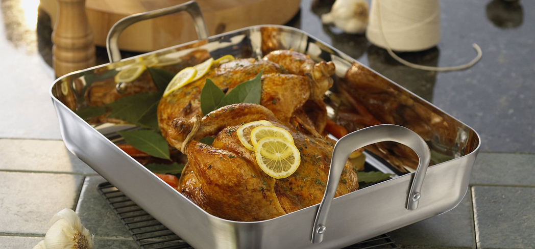 The Calphalon Stainless 16-Inch Roaster has stay-cool handles that extend high for easy transport