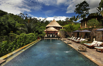 The main pool and lounge area at the Bagus Jati