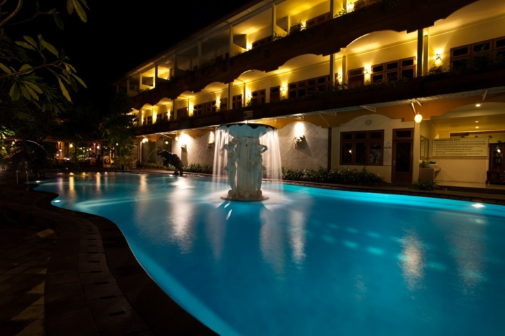 Night time at the main swimming pool at Febri's Hotel