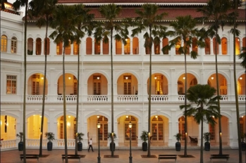 The Palm Court of the Raffles Hotel, Singapore in the evening