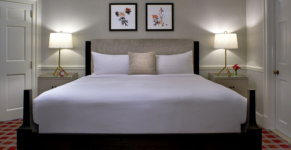 A king bed in a Kimpton Morrison House guest room