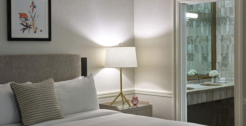 The bedside in a Kimpton Morrison House guest room