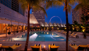 The Conrad Centennial Singapore's pool with a view of the Singapore Flyer