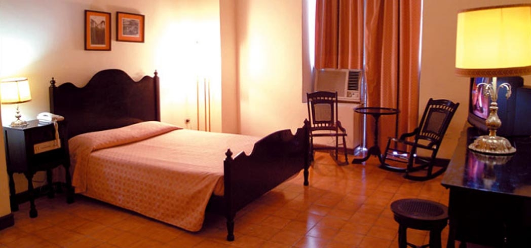 A guest room at Hotel Plaza in Havana