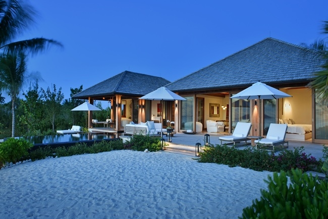 Parrot Cay by COMO's Love Pumpkin Guest Villa exterior in the evening
