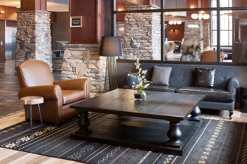 A stone-clad exterior sets the tone for the interior at Embassy Suites by Hilton Anchorage
