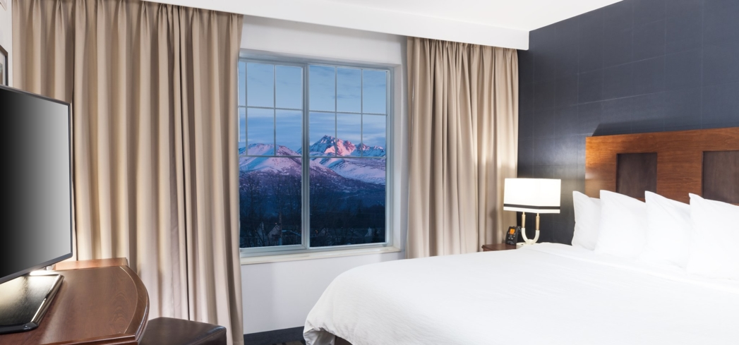 A guest room at Embassy Suites by Hilton Anchorage