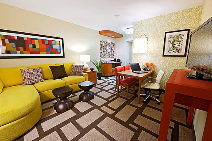 A comfortable and colorful room at Embassy Suites by Hilton Houston Downtown