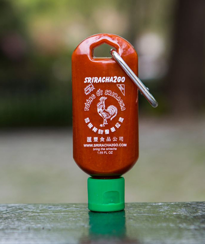 Fulfill your dreams of keeping hot sauce in your bag with Sriracha2Go's Keychain Bottle