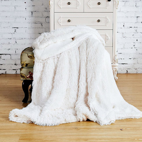 Stay cozy when the weather gets cold with the Faux Fur Throw Blanket, one of GAYOT's Top 10 Holiday Gifts