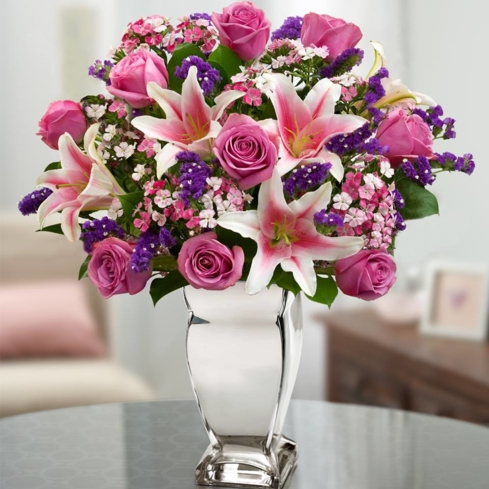 One of GAYOT's Top 10 Romantic Gifts, this colorful bouquet from 1-800-Flowers features Stargazer lilies and hot pink roses