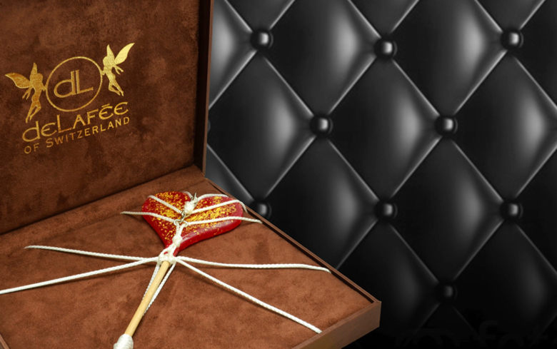 DeLafée's 50 Shades of Gold Lollipop is an edible take on 50 Shades of Grey
