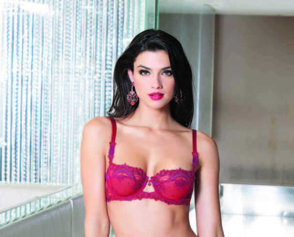 Lise Charmel's red lace pieces add a bold edge to the usual neutral tones found in lingerie