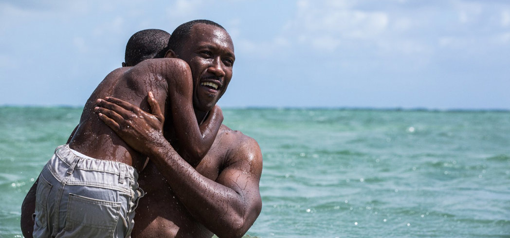 Mahershala Ali and Alex R. Hibbert in Moonlight, one of GAYOT's Top 10 Movies of 2016