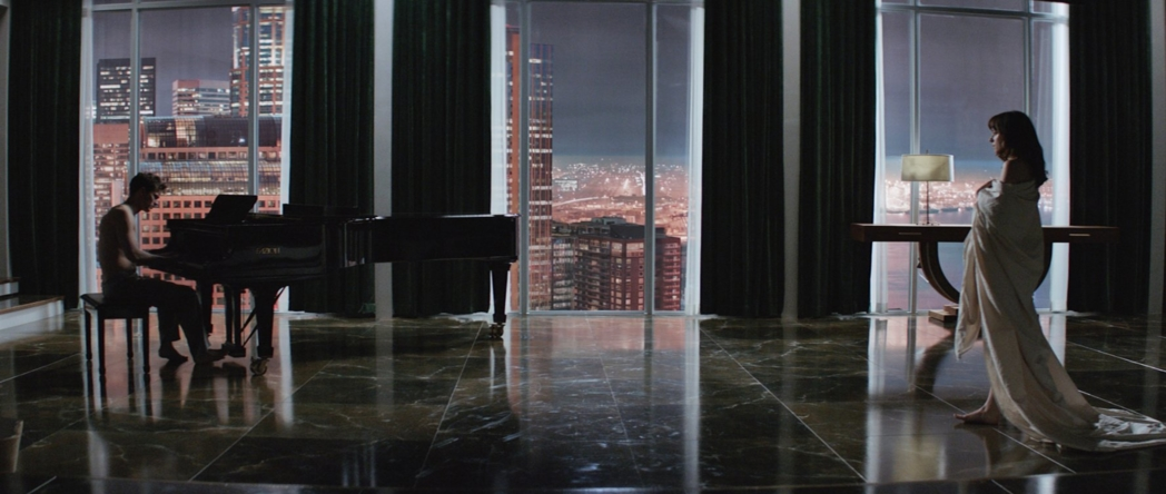 Christian Grey and Anastasia Steele in the young billionaire's penthouse apartment.