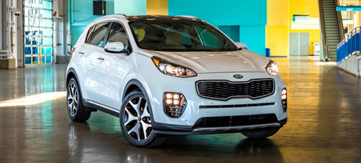 A three-quarter front view of a 2017 Kia Sportage AWD SUV