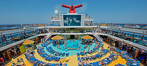 Soaking in the sun and a movie aboard a Carnival Cruise, one of GAYOT's Top 10 Caribbean Cruises