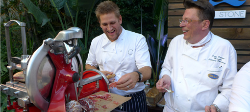 Chef Curtis Stone cooking with Peter Roelant, Manager of Culinary Operations of Princess Cruises