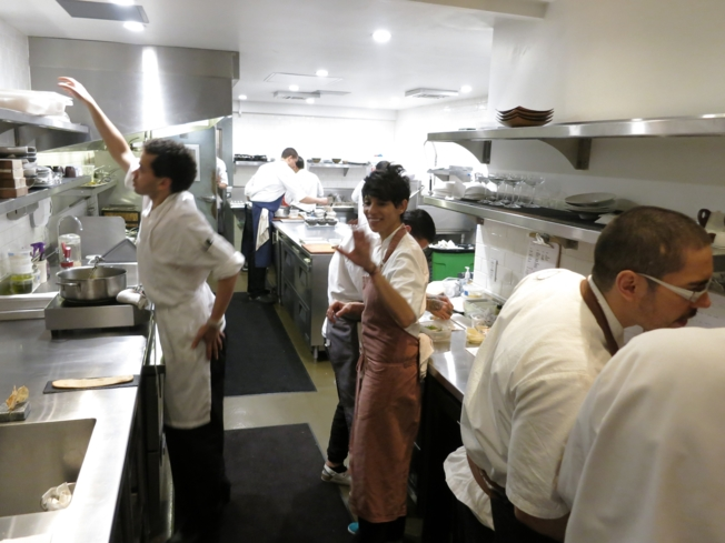 Chef Dominique Crenn in the kitchen with her team