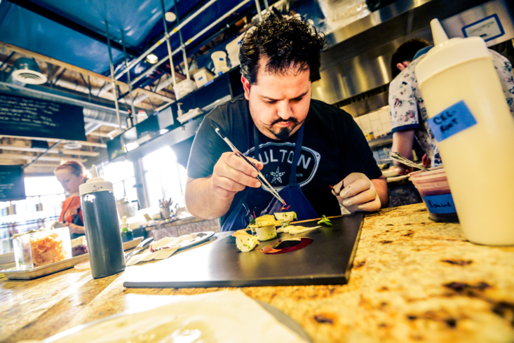 Travail Kitchen & Amusements, Robbinsdale MN: Chef Mike Brown plating a dish (photo Travis Anderson Photography)