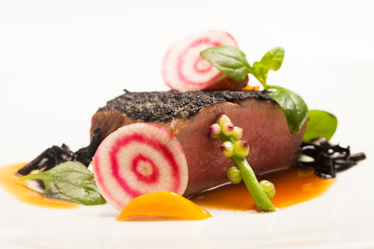 Tru's lamb loin draped in black trumpet, young beets