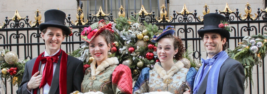 Holiday carolers serenade diners at The Lambs Club, one of GAYOT's Best Christmas Restaurants in New York