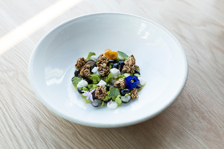 71Above: English peas, blueberries, strained yogurt, mint, sweet garlic, granola