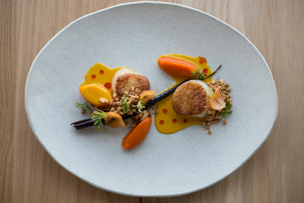 71Above: Scallops, carrot, vadouvan curry, coconut, barrel-aged fish sauce