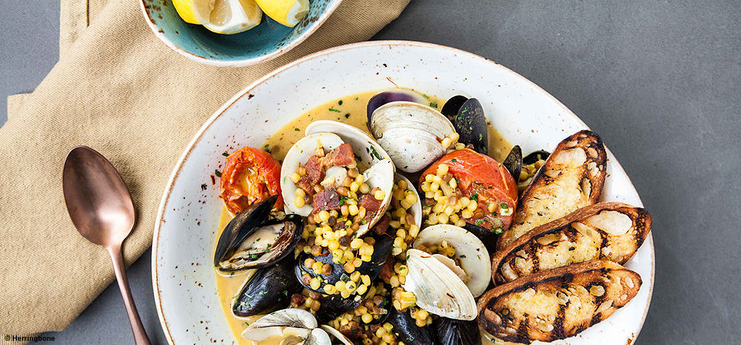 Indulge in mussels and more gourmet seafood at Herringbone in Las Vegas, NV