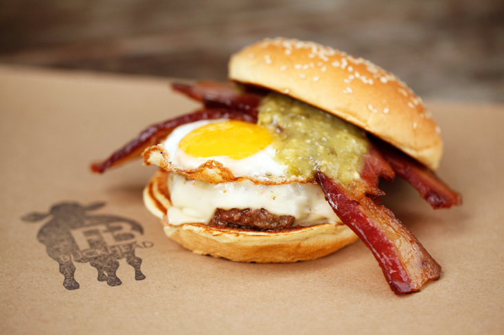 Burger with bacon, egg and salsa at Farm Burger in Decatur, GA