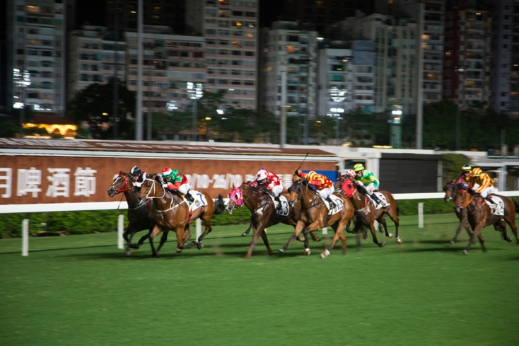 A horse race at Happy Valley Racecourse in Hong Kong