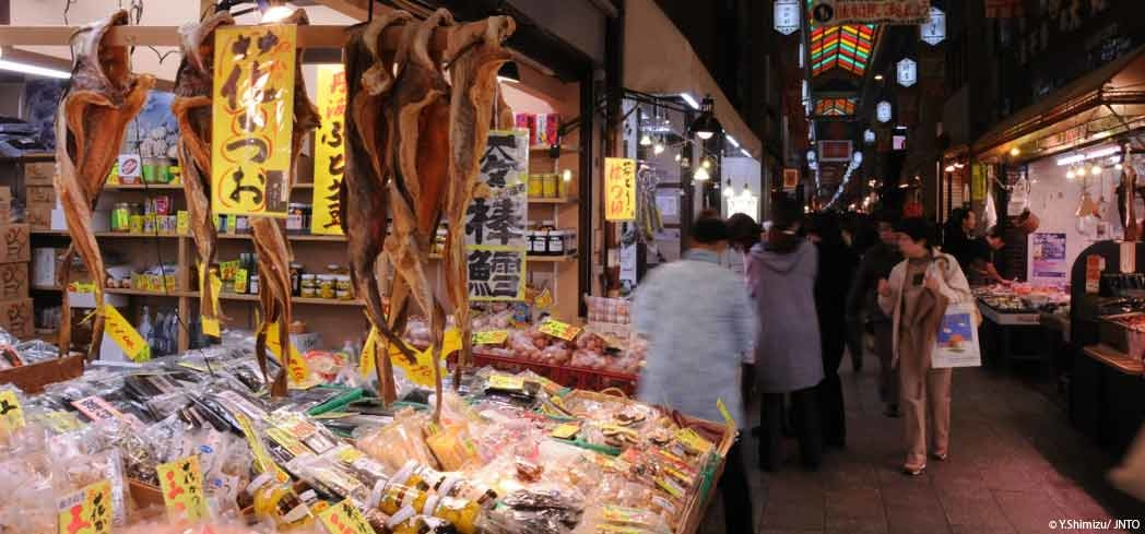 Shoppers browsing the goods at Nishiki Market in downtown Kyoto