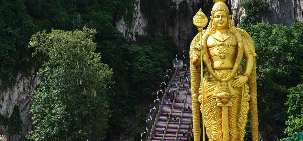 People ascending the stairs to the Batu Caves in Malaysia