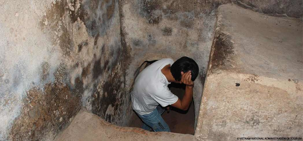 A visitor entering the Cu Chi Tunnels in Ho Chi Minh City, Vietnam