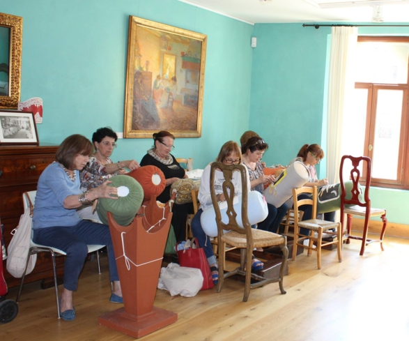 Women crafting lace at Museo del Merletto